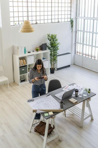 female design professional photographing floor plan