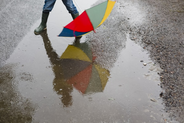 little boy with umbrella and rubber
