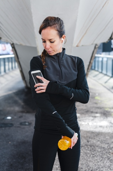 female athlete using smart phone over