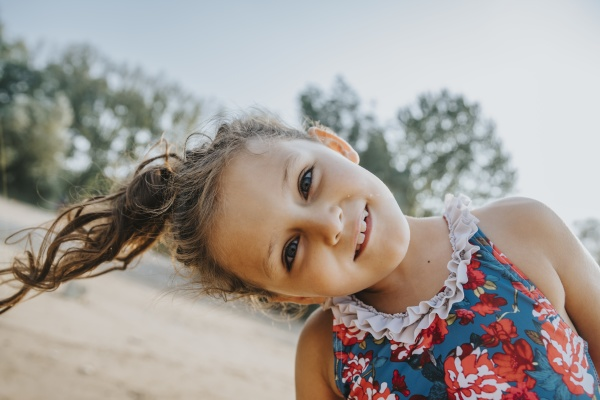 little girl smiling while standing at
