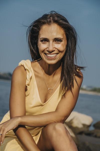 smiling mature woman sitting on rock