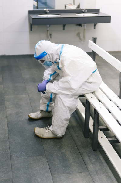 contemplating man wearing protective suit sitting