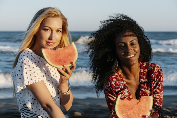 friends eating slice of watermelon on