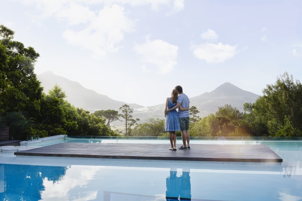 heterosexual couple looking at view while