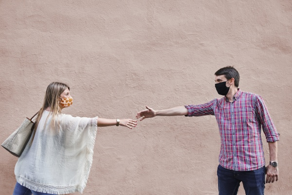 couple keeping social distance while standing