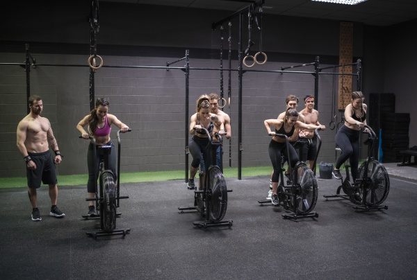 women exercising on fitness bike with