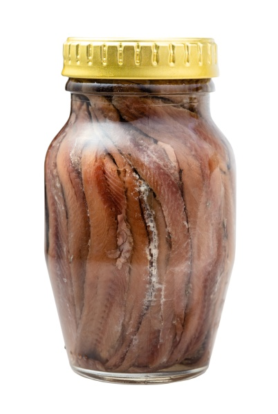 glass jar of canned anchovy fillets