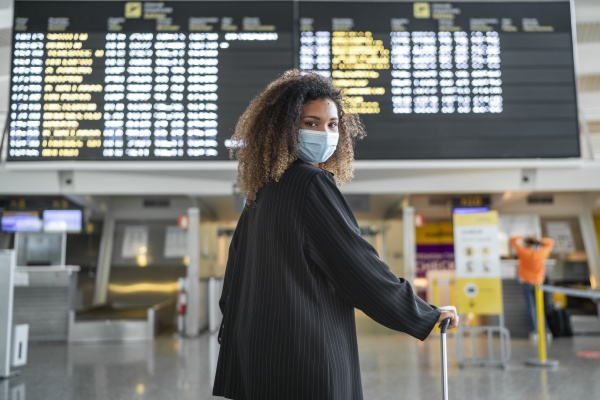 woman wearing protective face mask looking