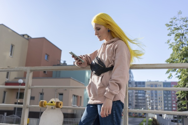 young woman text messaging on smart