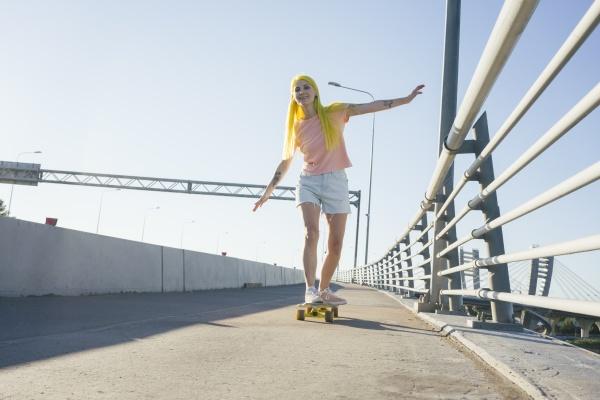 woman enjoying while skating on skateboard