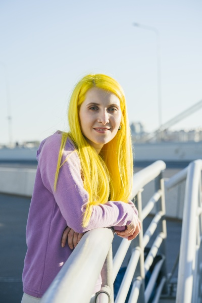 hipster female leaning on railing during