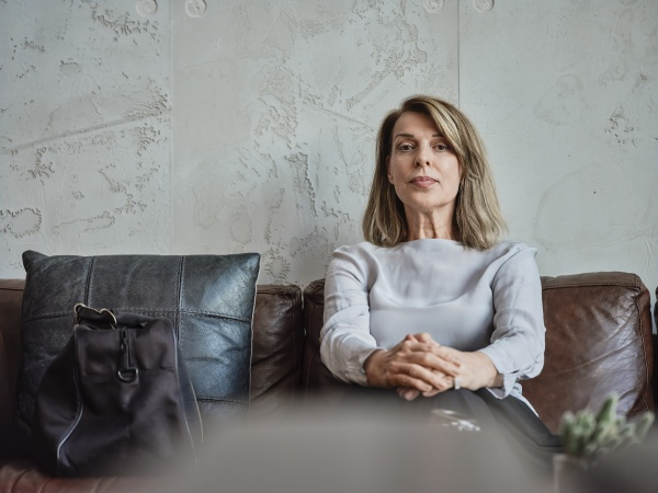 senior woman sitting on sofa in