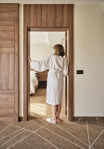 senior woman in bathrobe standing at