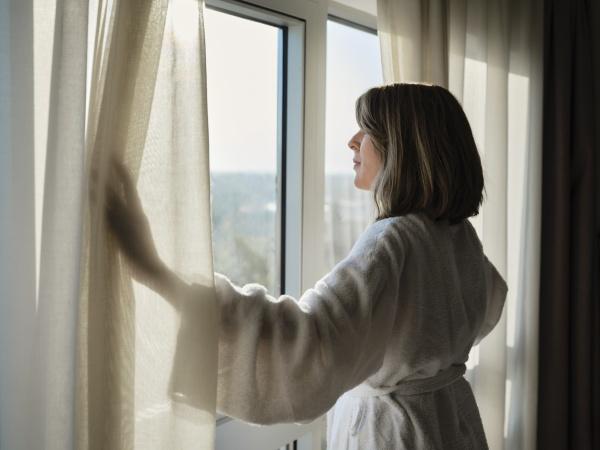 blond, senior, woman, opening, white, curtain - 29130008