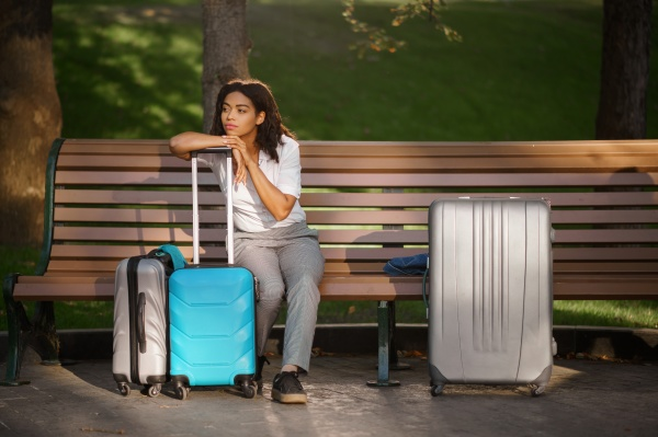 woman with suitcase sitting on the