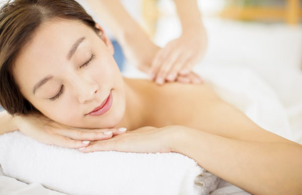 relaxed young woman enjoy massage in