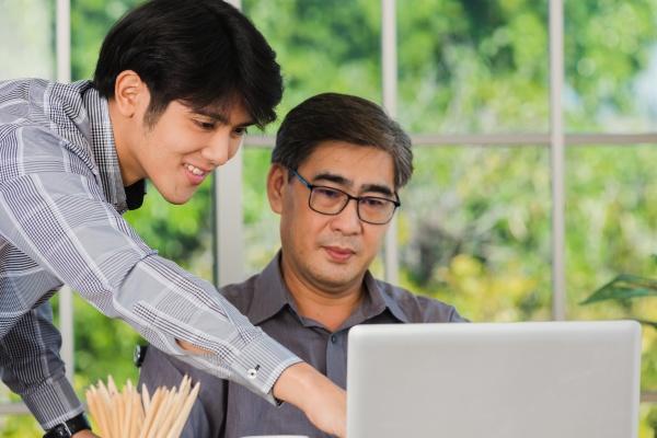 asian senior and junior two businessmen