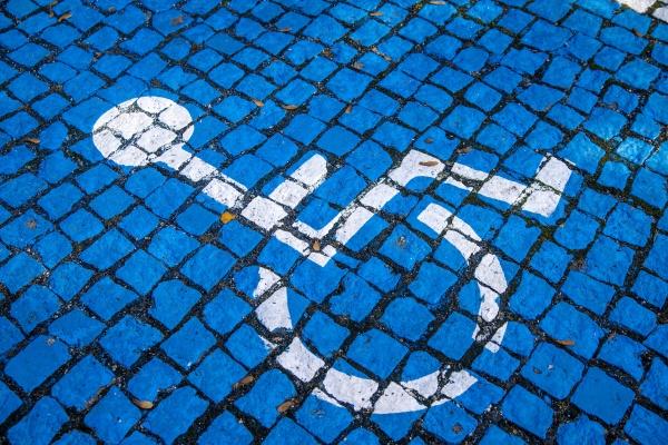 blue painted cobblestones parking for handicapped