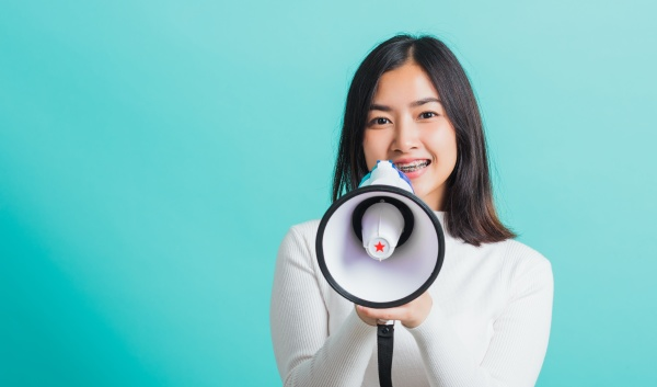 woman smile she holding megaphone making