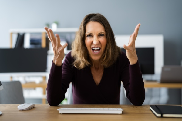 workplace quarrel angry looking woman