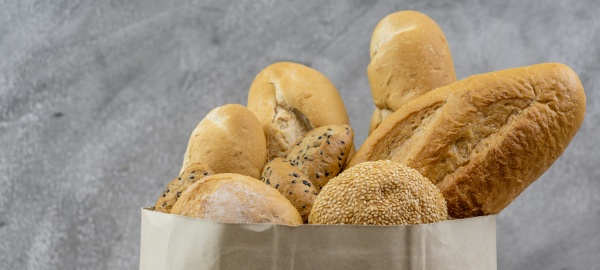 bread variety in disposalable paper bag