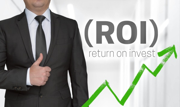 roi concept and businessman with thumbs