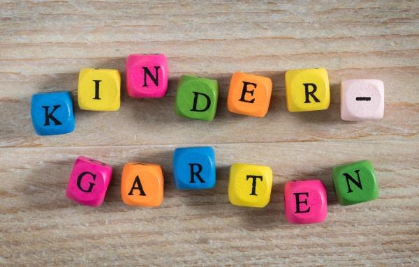 kindergarten letter cubes concept on wooden