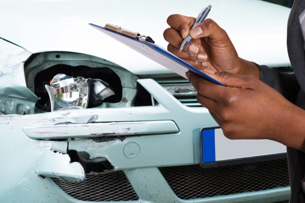 african american car insurance agent filling