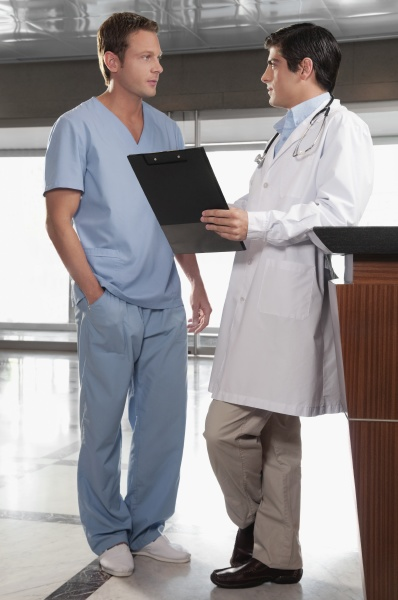 two doctors discussing a medical report