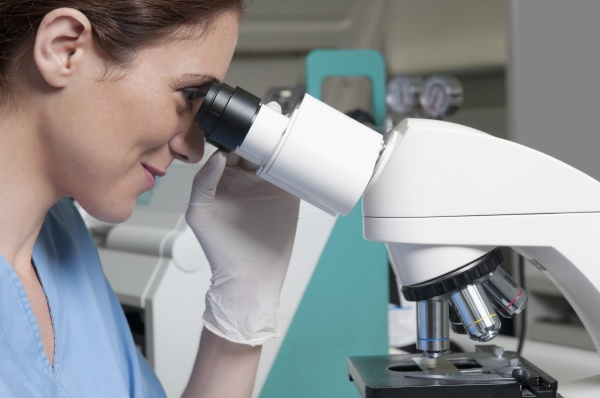 female lab technician analyzing a sample