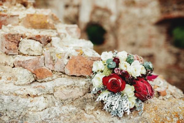 wedding bouquet on the broken brick