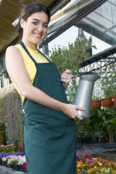 woman holding a watering can in