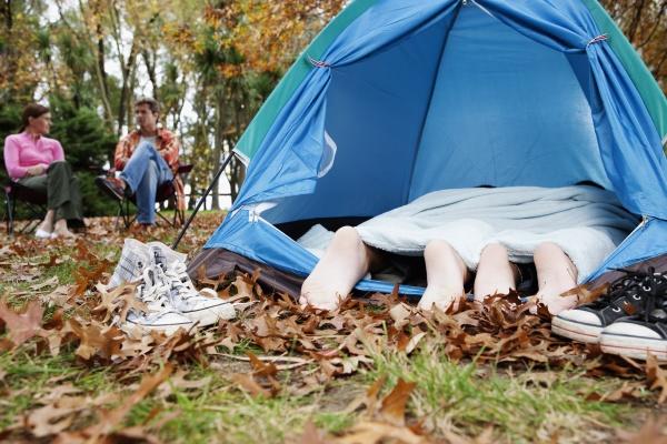 childZs feet under a tent