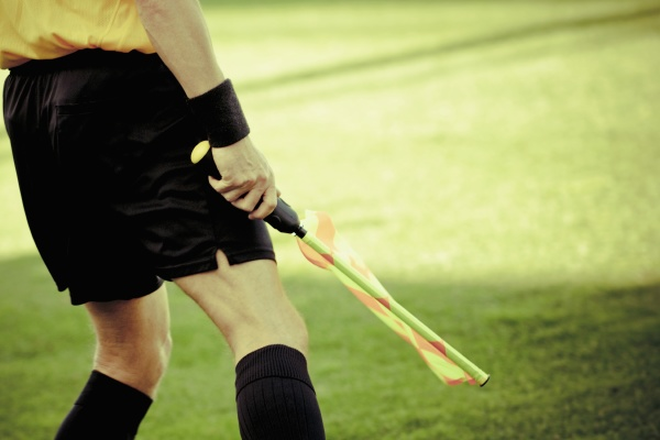 referee standing in a soccer field