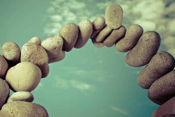 pebbles arranged in an arch shape