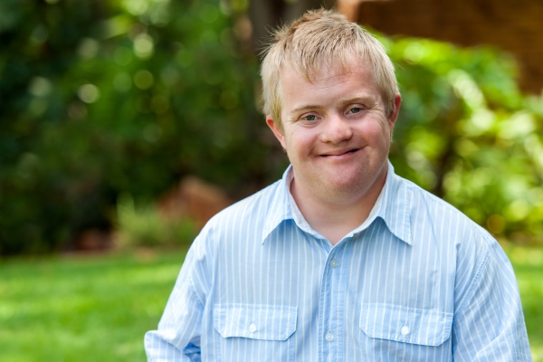 smiling handicapped boy outdoors