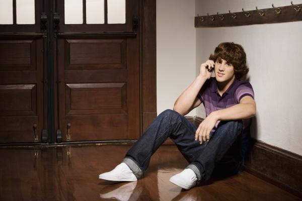 teenage boy talking on a mobile
