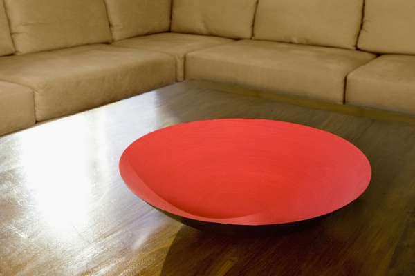 red painted bowl on a table