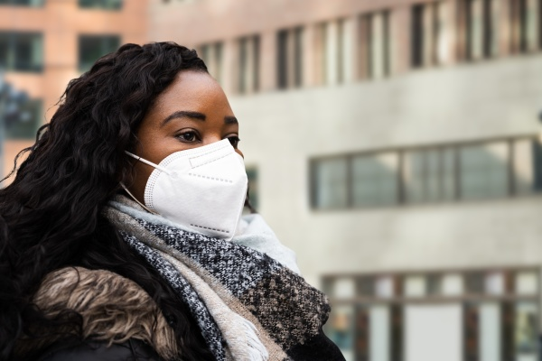 african american woman wearing medical face