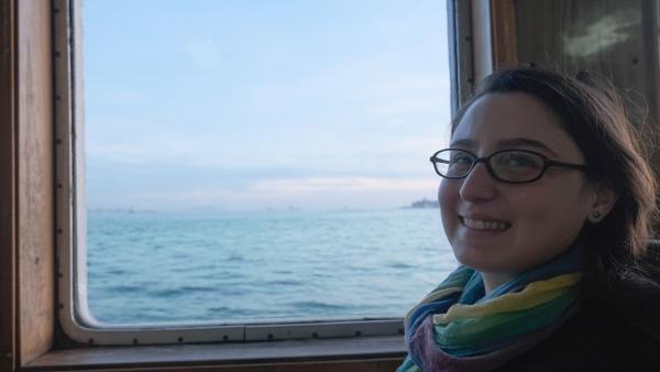 a woman smiles near the ship