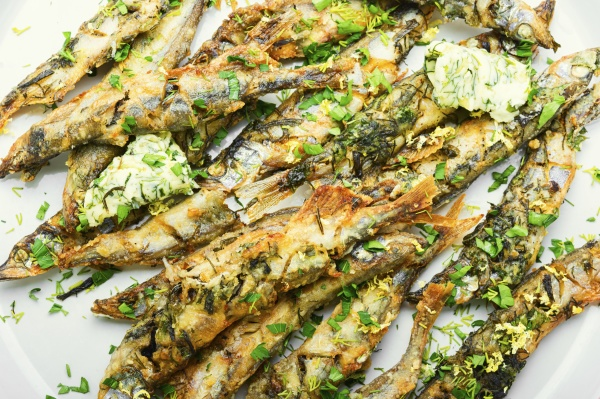 fried capelin fish on plate