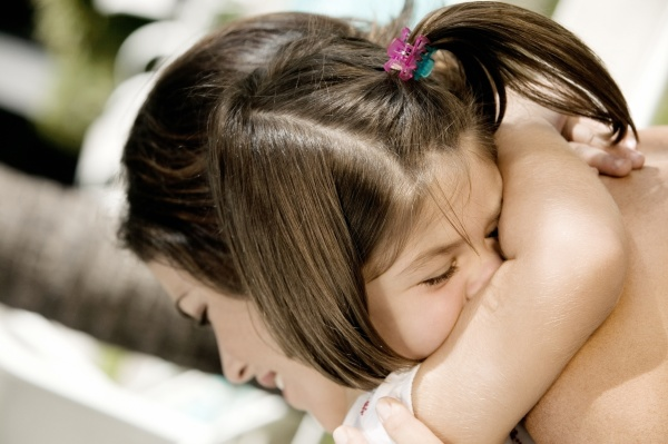 close up of a daughter hugging