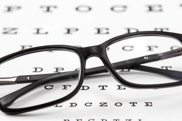 glasses on a eye sight test