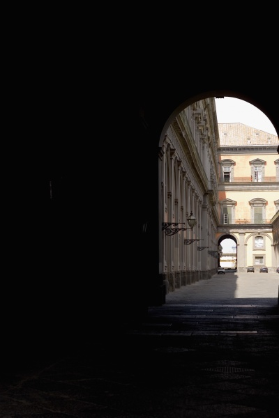 buildings viewed through an archway
