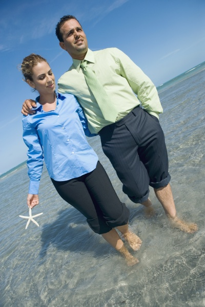 mid adult couple wading on the