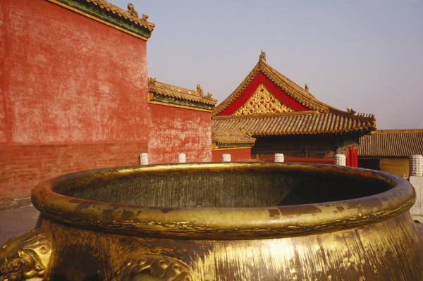golden decorative urn in a courtyard