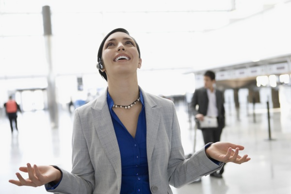 businesswoman laughing in a hands free