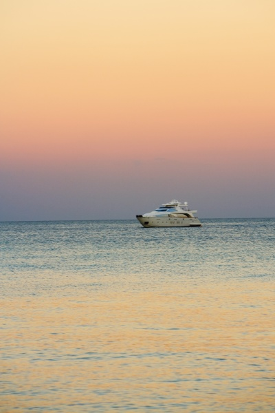 yacht in the sea at dusk