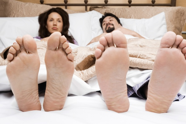 mid adult couple lying on the