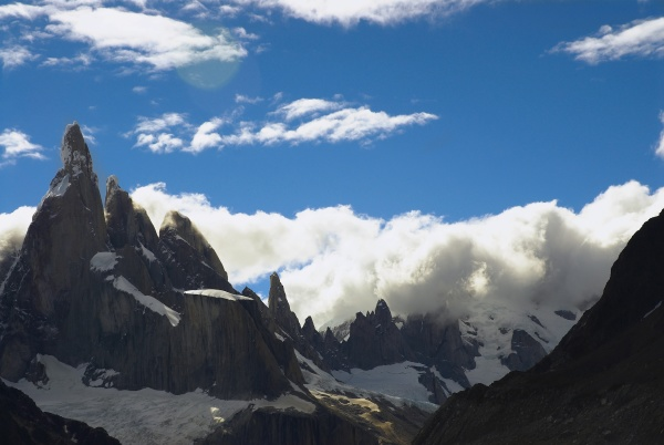 clouds over mountains cerro torre argentine